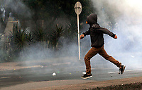 MEDELLIN, COLOMBIA - OCTOBER 24 A protestor flees as students clash with members of the Mobile Anti-Disturbance Squadron (ESMAD), during a protest in Medellin, Colombia, on October 24, 2019. Regional elections will take place on October 27 in Colombia. (Photo by Fredy Builes/VIEWpress)