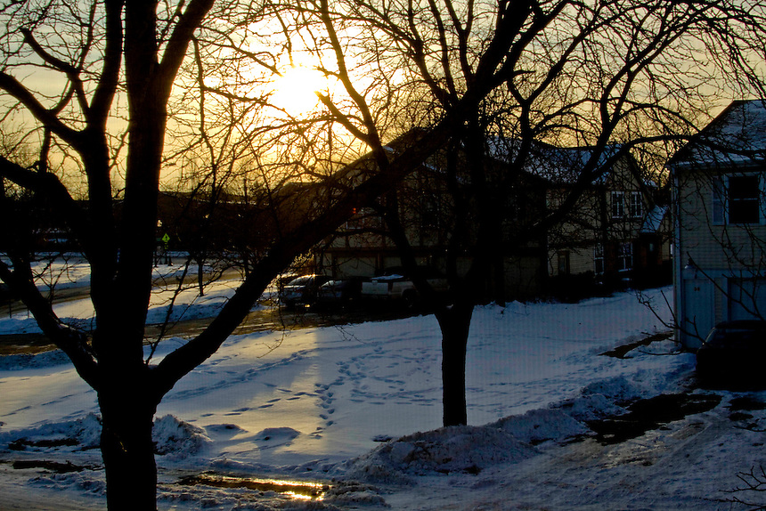 Winter sunset and the footprints in the snow.