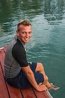 Honduras, Roatan Island, Fantasy Island Resort, Caribbean. Scuba dive master (Robin) at the dive shop.