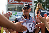 Aug. 4, 2013; Kent, WA, USA: NHRA pro stock driver Mike Edwards greets fans prior to the Northwest Nationals at Pacific Raceways. Mandatory Credit: Mark J. Rebilas-USA TODAY Sports