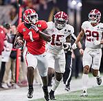 Georgia Bulldogs running back Sony Michel (1) looks back at Alabama Crimson Tide defensive back Ronnie Harrison (15) and Alabama Crimson Tide defensive back Minkah Fitzpatrick (29) on a long run in the first quarter of the NCAA College Football Playoff National Championship at Mercedes-Benz Stadium on January 8, 2018 in Atlanta. Photo by Mark Wallheiser/UPI