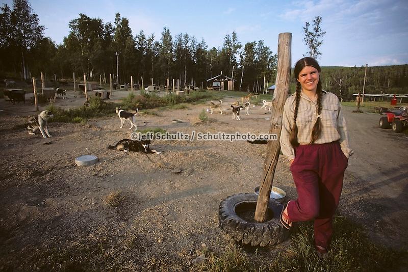 Iditarod Champion Susan Butcher Standing In Her Dog Lot Eureka Ak