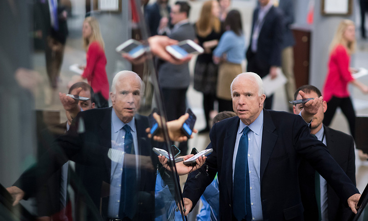 UNITED STATES - APRIL 7: Reporters question Sen. John McCain, R-Ariz., about Syria as he arrives for the confirmation vote on Supreme Court nominee Neil Gorsuch in the Capitol on Friday, April 7, 2017. (Photo By Bill Clark/CQ Roll Call)