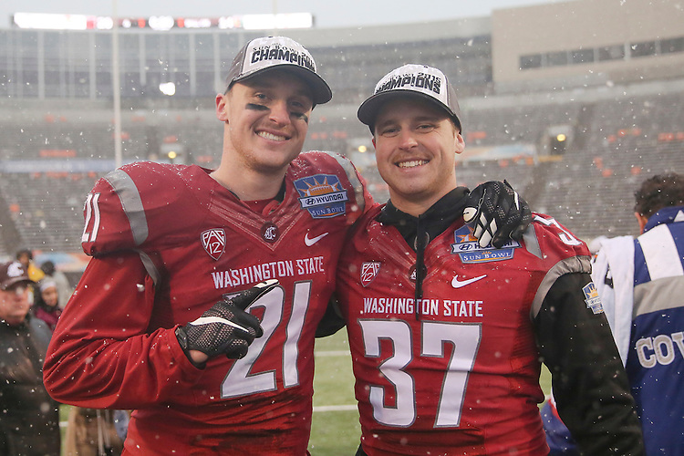 Brothers River Cracraft (21) and Skyler Cracraft (37), a Washington State University wide receiver and defensive back, pose for a victory photo after the Hyundai Sun Bowl game against the Miami Hurricanes in El Paso, Texas, on December 26, 2015.  In a game that could have been named the Snow Bowl instead of the Sun Bowl, WSU took a 20-7 lead in to halftime and then held off a Miami fourth quarter rally to win their first bowl game since the 2003 Holiday Bowl, 20-14.