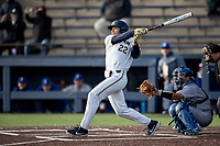 Michigan Wolverines outfielder Jordan Brewer (22) follows through on his swing against the San Jose State Spartans on March 27, 2019 in Game 2 of the NCAA baseball doubleheader at Ray Fisher Stadium in Ann Arbor, Michigan. Michigan defeated San Jose State 3-0. (Andrew Woolley/Four Seam Images)