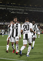 Calcio, Serie A: Fiorentina - Juventus, stadio Artemio Franchi Firenze 1 dicembre 2018.<br /> Juventus' Rodrigo Bentancur (c) celebrates after scoring with his teammates Paulo Dybala (l) and Joao Cancelo (r) during the Italian Serie A football match between Fiorentina and Juventus at Florence's Artemio Franchi stadium, December 1, 2018.<br /> UPDATE IMAGES PRESS/Isabella Bonotto