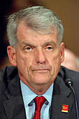 """Timothy J. Sloan, Chief Executive Officer and President, Wells Fargo & Company, testifies before the United States Senate Committee on Banking, Housing, and Urban Affairs as they conduct a hearing entitled, """"Wells Fargo: One Year Later"""" on Capitol Hill in Washington, DC on Tuesday, October 3, 2017. <br /> Credit: Ron Sachs / CNP"""