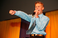 Thursday March 4, 2010      .Conway Seavey , youngest son of Mitch and Janine Seavey rocks out while entertaining the crowd at the musher's drawing banquet in Anchorage ...