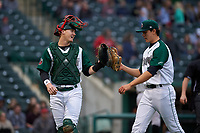 Fort Wayne TinCaps catcher Blake Hunt (12) talks to starting pitcher Joey Cantillo (22) as they walk off the field during a Midwest League game against the Quad Cities River Bandits at Parkview Field on May 3, 2019 in Fort Wayne, Indiana. Quad Cities defeated Fort Wayne 4-3. (Zachary Lucy/Four Seam Images)