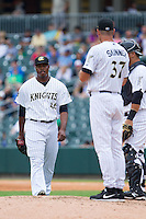 Charlotte Knights manager Joel Skinner (37) calls for relief pitcher Donnie Veal (46) during the game against the Pawtucket Red Sox at BB&T Ballpark on August 10, 2014 in Charlotte, North Carolina.  The Red Sox defeated the Knights  6-4.  (Brian Westerholt/Four Seam Images)