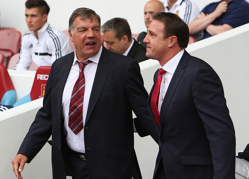 L-R West Ham United's Manager Sam Allardyce  and Cardiff City's Manager Malky Mackay coming out for the new season<br />  (Photo by Kieran Galvin/CameraSport) <br /> <br /> Football - Barclays Premiership - West Ham United v Cardiff City - Saturday 17th August 2013 - The Boleyn Ground - London<br /> <br /> &copy; CameraSport - 43 Linden Ave. Countesthorpe. Leicester. England. LE8 5PG - Tel: +44 (0) 116 277 4147 - admin@camerasport.com - www.camerasport.com