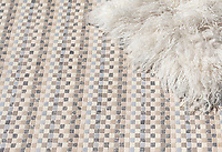 Flatweave, a hand-cut stone mosaic, shown in tumbled Pacifica, Driftwood, Cavern, Bianco Antico, Lagos Gold, and Botticino, is part of the Tissé® collection designed by Paul Schatz for New Ravenna.