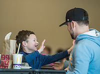 NWA Democrat-Gazette/ANTHONY REYES @NWATONYR<br /> John Bennet plays with his son Jude Bennet, 6, Friday, Feb. 3, 2017 after they ate lunch together at Willowbrook Elementary School in Bentonville. Bennet said he or his wife try to come and eat lunch with Jude a couple of times a month. More parents have taken the time to occasionally eat lunch with their children at school.
