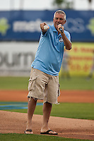 Daytona Cubs owner Andrew Rayburn prepares to throw a ball into the crowd before the Daytona Cubs home opener at Jackie Robinson Ballpark on April 6, 2012 in Daytona Beach, Florida. (Scott Jontes / Four Seam Images)