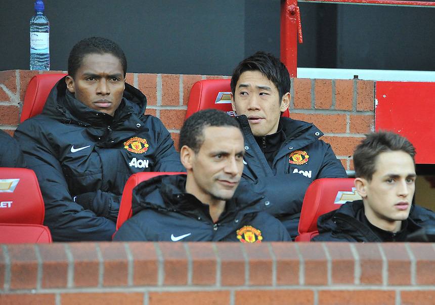 Manchester United's Shinji Kagawa watches the match from the bench<br /> <br /> Photo by Dave Howarth/CameraSport<br /> <br /> Football - Barclays Premiership - Manchester United v Fulham - Sunday 9th February 2014 - Old Trafford - Manchester<br /> <br /> &copy; CameraSport - 43 Linden Ave. Countesthorpe. Leicester. England. LE8 5PG - Tel: +44 (0) 116 277 4147 - admin@camerasport.com - www.camerasport.com