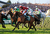 14h April 2018, Aintree Racecourse, Liverpool, England; The 2018 Grand National horse racing festival sponsored by Randox Health, day 3; Eventual race winner Tiger Roll after the water jump in The Grand National