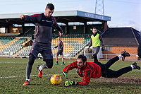 Pictured: Goalkeeper James Bittner (R) dives to save the ball. Thursday 18 January 2018<br /> Re: Players and staff of Newport County Football Club prepare at Newport Stadium, for their FA Cup game against Tottenham Hotspur in Wales, UK