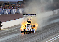 Oct 29, 2016; Las Vegas, NV, USA; NHRA top fuel driver Richie Crampton has an engine fire during qualifying for the Toyota Nationals at The Strip at Las Vegas Motor Speedway. Mandatory Credit: Mark J. Rebilas-USA TODAY Sports