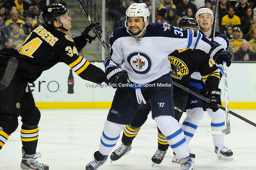 January 2, 2014 - Boston, Massachusetts, U.S. - Boston Bruins center Carl Soderberg (34) and Winnipeg Jets defenseman Dustin Byfuglien (33) in game action during the NHL game between Winnipeg Jets and the Boston Bruins held at TD Garden in Boston Massachusetts.  Boston defeated Winnipeg 4-1 in regulation. Eric Canha/CSM
