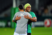 Mosese Ratuvou of Pau embraces Dan Bowden of Bath Rugby during the pre-match warm-up. European Rugby Challenge Cup match, between Pau (Section Paloise) and Bath Rugby on October 15, 2016 at the Stade du Hameau in Pau, France. Photo by: Patrick Khachfe / Onside Images
