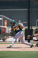 Oakland Athletics catcher Santis Sanchez (55) follows through on his swing during an Extended Spring Training game against the San Francisco Giants Orange at the Lew Wolff Training Complex on May 29, 2018 in Mesa, Arizona. (Zachary Lucy/Four Seam Images)