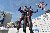 #15 Multimatic Motorsports Ford Mustang GT4, GS: Austin Cindric, Sebastian Priaulx celebrate the win in victory lane