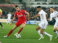 SWANSEA, WALES - MARCH 16: L-R Jordan Henderson of Liverpool is marked by Neil Taylor of Swansea during the Premier League match between Swansea City and Liverpool at the Liberty Stadium on March 16, 2015 in Swansea, Wales
