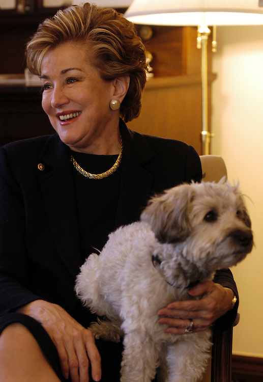 Sen. Elizabeth Dole, R-NC, and her dog, Leader II, at an interview in her office.