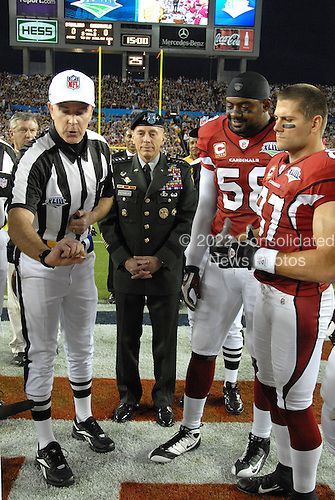 Tampa, FL - February 1, 2009 -- United States Army General David H. Petraeus, Commander, United States Central Command (CENTCOM), center, watches as head Super Bowl XLIII Referee, Terry McAulay, left, tosses the coin to decide who kicks off to open the game at Super Bowl XLIII, Sunday, February 1, 2009, at Raymond James Stadium in Tampa, Florida. .Credit: Bradley Lail - USAF via CNP