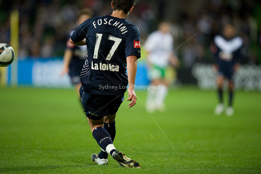 MELBOURNE, AUSTRALIA - May 14, 2010: Matthew Foschini from Melbourne Victory kicks the ball in the Kevin Muscat Testimonial match between the Melbourne Victory and Come Play XI at AAMI Park on May 14, 2010 in Melbourne, Australia. Photo Sydney Low www.syd-low.com
