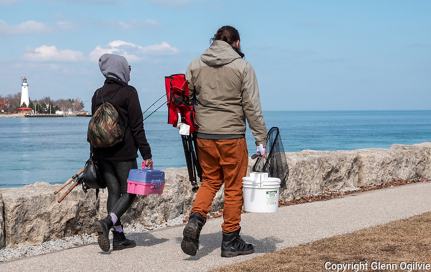 "Olivia Cocuthier and Justin Mellott, of London Ont., head out for a chilly afternoon of fishing along the St. Clair River at the water treatment plant. ""We've been up here a few times,"" Olivia said "" we're hoping to catch something today, we're looking for walleye, but we'll see."""