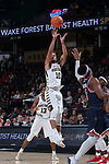 Mitchell Wilbekin (10) of the Wake Forest Demon Deacons fires up a shot during second half action against the Richmond Spiders at the LJVM Coliseum on December 2, 2017 in Winston-Salem, North Carolina.  The Demon Deacons defeated the Spiders 82-53.  (Brian Westerholt/Sports On Film)