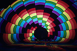 Looking inside a hot air balloon before lift-off with multi-colored patterns against morning light Redmond Washington State USA