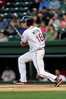 Catcher Jordan Weems (18) of the Greenville Drive bats in a game against the Asheville Tourists on Monday, April 21, 2014, at Fluor Field at the West End in Greenville, South Carolina. Weems was a 3rd Round pick of the Boston Red Sox in the 2011 First-Year Player Draft. Greenville won, 8-3. (Tom Priddy/Four Seam Images)