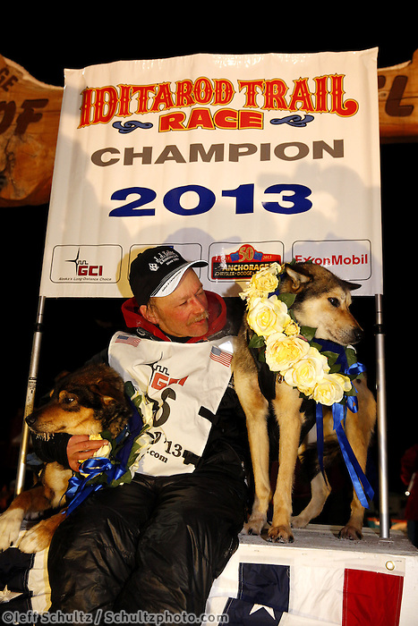 Mitch Seavey with his lead dogs Tanner, left, and Taurus after arriving in Nome first and winning his second Iditarod sled dog race on Tuesday March 12, 2013. Seavey made the journey from Willow in 9 days, 7 hours, 39 minutes, 56 seconds. ..Iditarod Sled Dog Race 2013..Photo by Jeff Schultz copyright 2013 DO NOT REPRODUCE WITHOUT PERMISSION