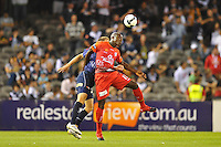 MELBOURNE, AUSTRALIA - JANUARY 23, 2010: Lloyd Owusu from Adelaide United heads the ball in round 24 of the A-league match between Melbourne Victory and Adelaide United FC at Etihad Stadium on January 23, 2010 in Melbourne, Australia. Photo Sydney Low www.syd-low.com