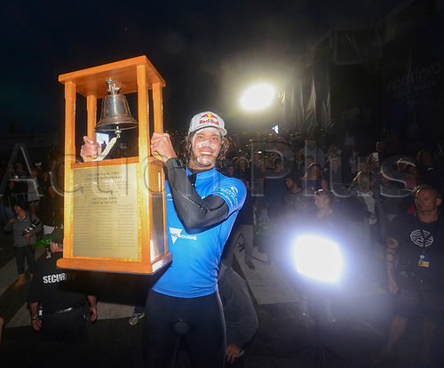 April 19th Bells Beach, Melbourne, Victoria, Australia; Rip Curl Pro Bells Beach Surfing; Jordy Smith (ZAF) poses alongside the bell trophy after winning the 2017 Bells Beach Rip Curl Pro; Smith defeated Caio Ibelli (BRA)