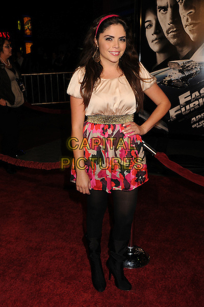 """YAREL RAMOS.""""Fast & Furious"""" Los Angeles Premiere at the Universal City Walk Gibson Amphitheatre, Universal City, California, USA..March 12th, 2009.full length black tights print red pattern skirt cream white top hand on hip silk satin.CAP/ADM/BP.©Byron Purvis/AdMedia/Capital Pictures."""