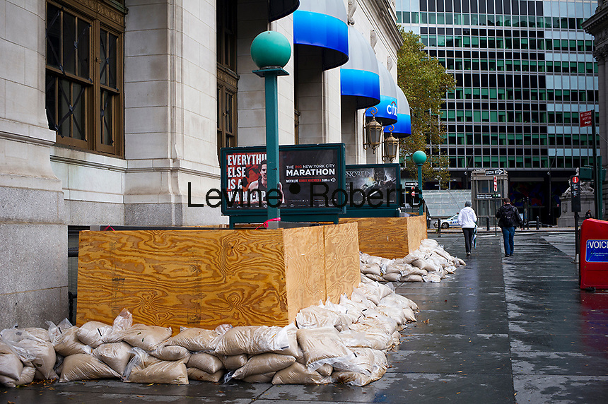 A subway entrance boarded up to prevent flooding into the subway station and tracks from Hurricane Sandy seen in downtown New York on Tuesday, October 30, 2012. Hurricane Sandy roared into New York disrupting the transit system and causing widespread power outages. Con Edison is estimating it will take four days to get electricity back to Lower Manhattan. (© Frances M. Roberts)