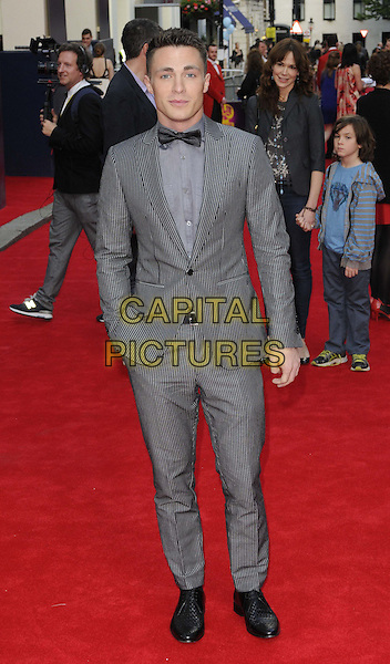 Colton Haynes<br /> 'Charlie And The Chocolate Factory' press night, Theatre Royal, Drury Lane, London, England.<br /> 25th June 2013<br /> full length suit tuxedo hand in pocket grey gray shirt bow tie black stripe pinstripe<br /> CAP/CAN<br /> &copy;Can Nguyen/Capital Pictures