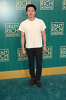 HOLLYWOOD, CA - AUGUST 7: Steven Yeun at the premiere of Crazy Rich Asians at the TCL Chinese Theater in Hollywood, California on August 7, 2018. <br /> CAP/MPI/DE<br /> &copy;DE//MPI/Capital Pictures