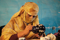 A girl works on December 11, 2003, in the Saharawi refugee camps. Saharawi people have been living at the refugee camps of the Algerian desert named Hamada, or desert of the deserts, for more than 30 years now. Saharawi people have suffered the consecuences of European colonialism and the war against occupation by Moroccan forces. Polisario and Moroccan Army are in conflict since 1975 when Hassan II, Moroccan King in 1975, sent more than 250.000 civilians and soldiers to colonize the Western Sahara when Spain left the country. Since 1991 they are in a peace process without any outcome so far. (Ander Gillenea / Bostok Photo)