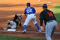 Adam Engel (26) of the Great Falls Voyagers slides into third base with Ogden Raptors third baseman Adam Law (22) and Voyagers manager Pete Rose Jr. (14) at Lindquist Field on August 14, 2013 in Ogden Utah. (Stephen Smith/Four Seam Images)