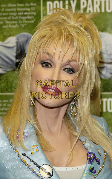 "DOLLY PARTON.signs copies of her new album ""Halos and Horns"" at HMV.bad makeup, heavy makeup.www.capitalpictures.com.sales@capitalpictures.com.© Capital Pictures"
