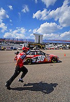 Oct 3, 2008; Talladega, AL, USA; NASCAR Sprint Cup Series driver Carl Edwards heads into the garage as a crew member runs alongside during practice for the Amp Energy 500 at the Talladega Superspeedway. Mandatory Credit: Mark J. Rebilas-