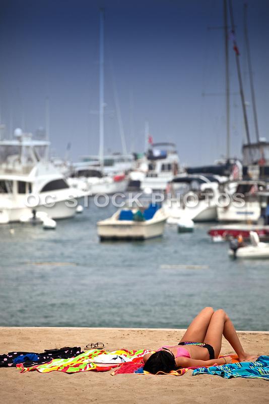 Girl Tanning on the Beach on Catalina Island