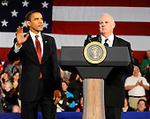 Elkhart, IN - February 9, 2009 -- United States President Barack Obama (L) quiets the crowd as he is introduced by Ed Neufeldt (R), an unemployed RV worker, at a town hall meeting in Elkhart, Indiana, USA 09 February 2009. Obama is seeking public support for his economic stimulus plan by taking to the road to visit hard hit areas of the country. The unemployment rate in Elkhart is over 15%, triple the rate of December 2008..Credit: Tannen Maury - Pool via CNP.