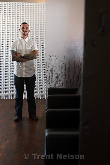 Trent Nelson  |  The Salt Lake Tribune.Andrew Valtal is the owner of Ulysses salon in Salt Lake City, Utah. Friday, July 22, 2011.