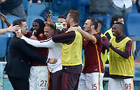 Calcio, Serie A: Roma vs Lazio. Roma, stadio Olimpico, 8 novembre 2015.<br /> Roma's Gervinho, second from left, celebrates with teammates after scoring during the Italian Serie A football match between Roma and Lazio at Rome's Olympic stadium, 8 November 2015.<br /> UPDATE IMAGES PRESS/Riccardo De Luca