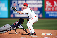 Ball State Cardinals first baseman Caleb Stayton (34)  waits for a throw as Logan Taylor (24) dives back to first during a game against the Louisville Cardinals on February 19, 2017 at Spectrum Field in Clearwater, Florida.  Louisville defeated Ball State 10-4.  (Mike Janes/Four Seam Images)